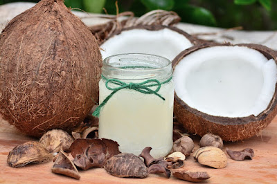 Remedies to get rid of dry, itchy scalp and dandruff- Coconut oil- NWoBS Blog