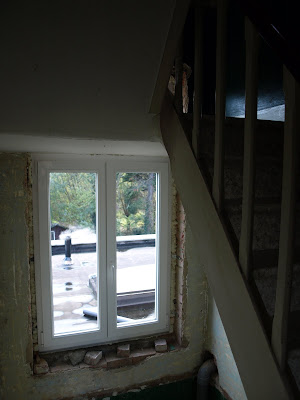 lower part to the second floor landing window