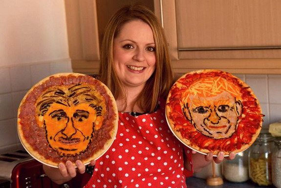 Lucy Whitaker poses with her 'Manuel Pepperoni' and 'Moyzzarella' pizzas