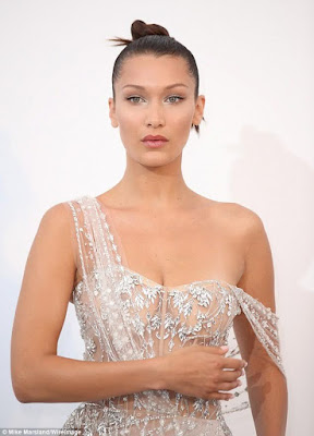 3 - Two wardrobe malfunctions in one night; Bella Hadid flashes her underwear and some skin in two dresses with crotch-high slit