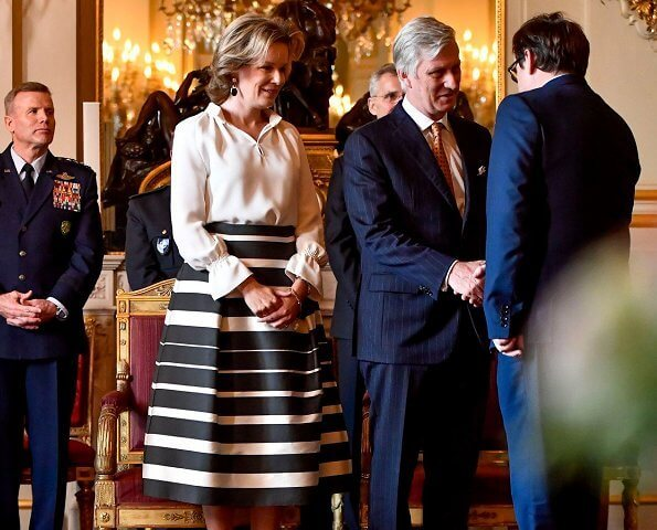 Queen Mathilde held a new year's reception at the royal palace in Brussels. Queen Mathilde wore a striped midi skirt by Natan