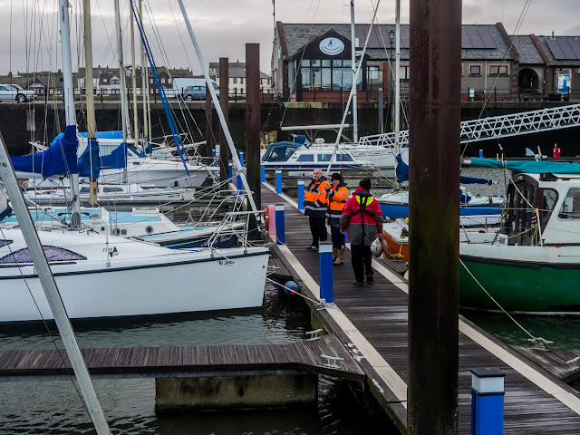 Photo of marina staff checking the boats and pontoons after the storm