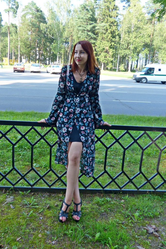 Floral overdress over black mini dress