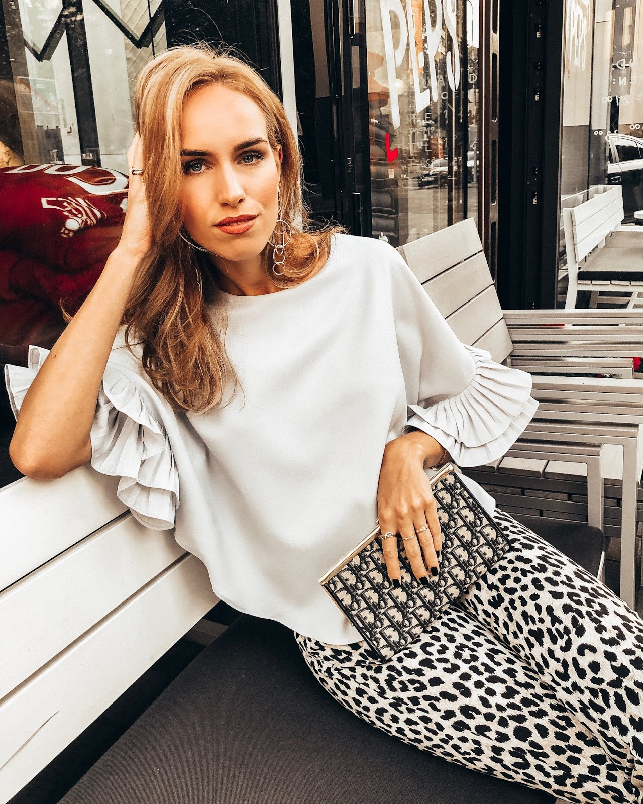 leopard print trousers ruffle sleeve top outfit