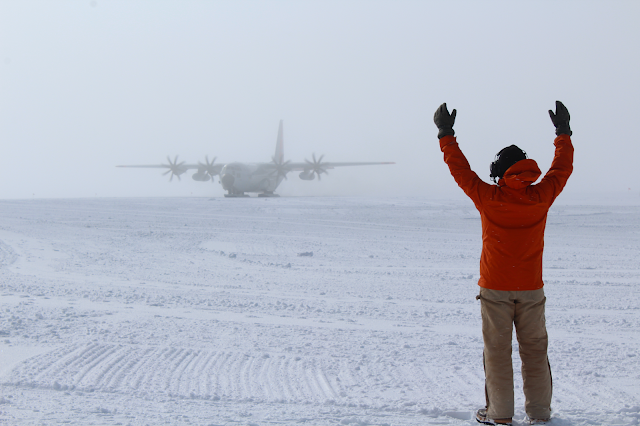 Man directing large place in the Arctic