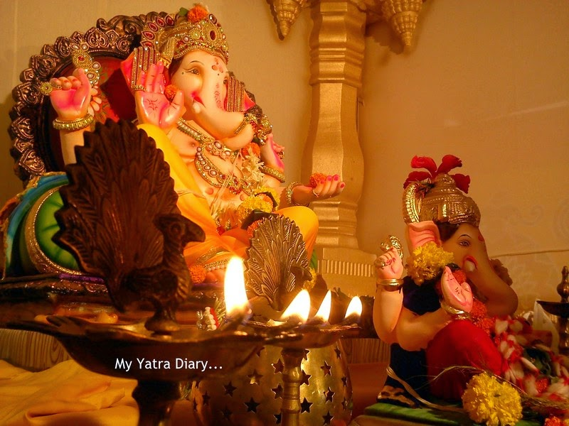 Mumbai Ganpati Pandal Hopping, decorated with lights, flowers and coconuts during Ganesh Chaturthi aarti