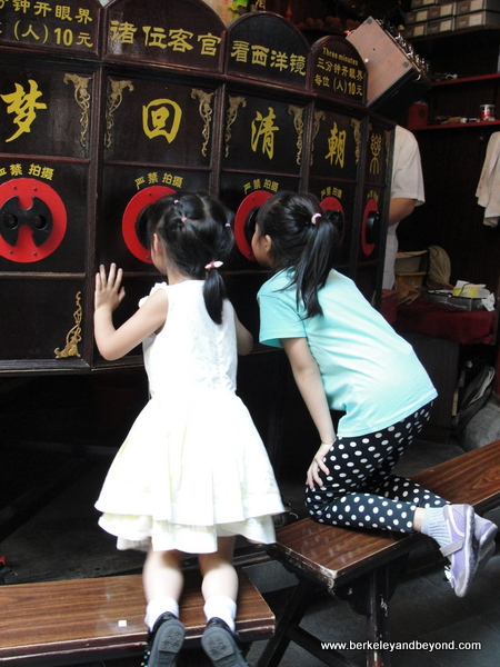 children enjoying peep show in Old City in Shanghai, China