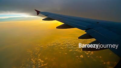 foto sunrise dari dalam pesawat