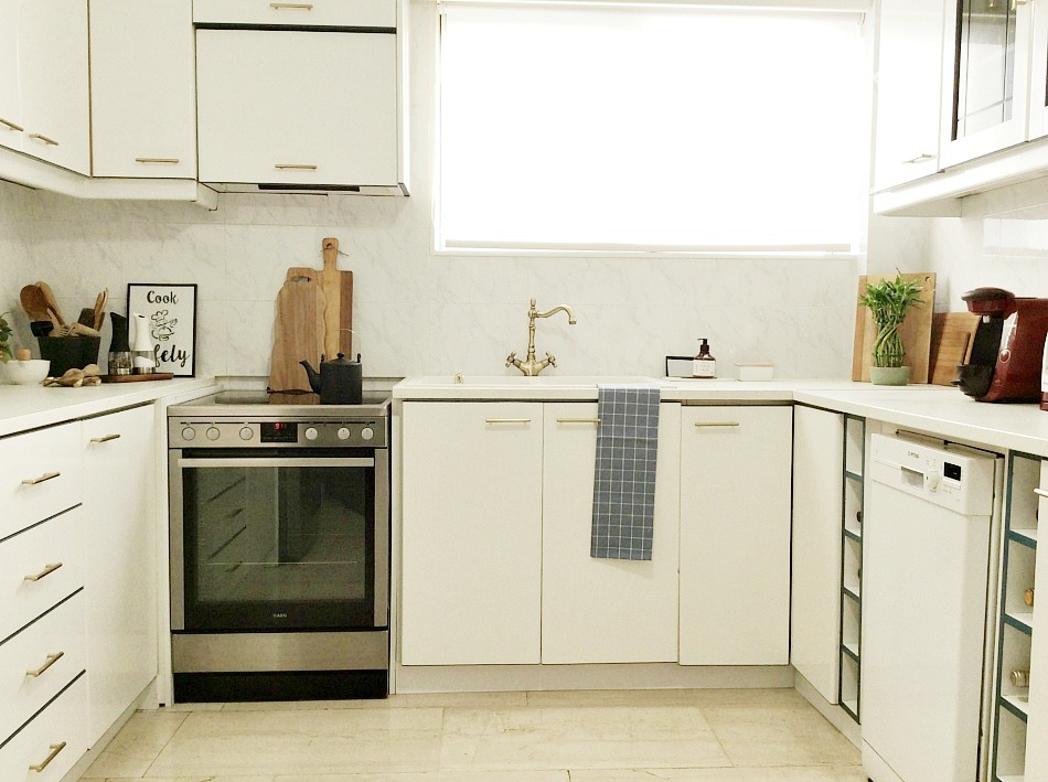 Kitchen makeover, white cabinets with blue details, brass handles