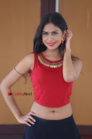 Telugu Actress Nishi Ganda Stills in Red Blouse and Black Skirt at Tik Tak Telugu Movie Audio Launch .COM 0355.JPG