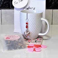 This lovely Valentine Tea Gift Set includes a Beaded Heart Infuser with hand blended loose leaf tea, pink and red sugar slices, and packaged in a gift bag with a gift tag.