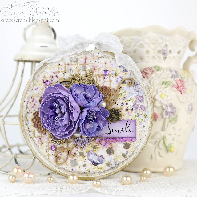 """Smile"" Altered Mixed Media Embroidery Hoop with Handcrafted Silk Foam Flowers by Tracey Sabella for Scrap & Craft: #studio75 #agateria #mixedmedia #alteredembroideryhoop #altered  #alteredhoop #chipboard #Finnabair #Primamarketing #homedecor #rangerink #lindysgang #lindysstampgang #spellbinders #helmar #shabbychic #papercrafting #wildorchidcrafts #handcraftedflowers #foamiran #foamiranflowers usartquestprills"