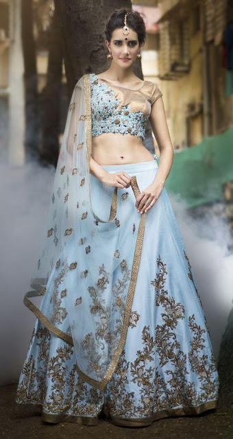 Featuring blue bridal lehenga with crafted handwork encrusted with crystal, sequin, beading and bugle beds with mesmerizing motives.