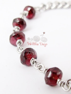 Close Up of Wire wrapped Minima Bracelet (Minlet) with Garnet and Box Link Stainless Steel Chain