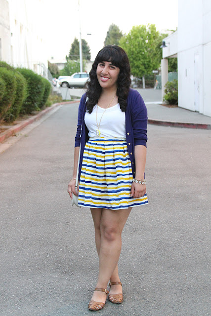 White T-Shirt Styled with a Striped Skirt and Cardigan