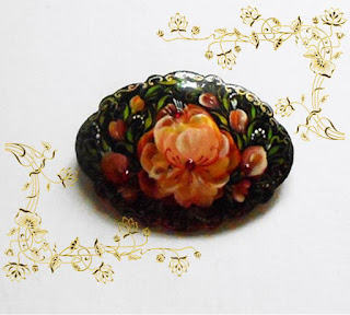The brooch with the author's hand-painted in Russian style Volkhovskaya in handmade.