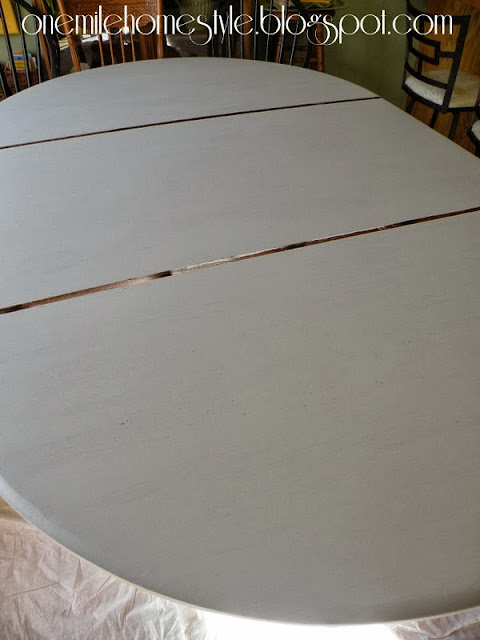 Dining table with second coat of paint
