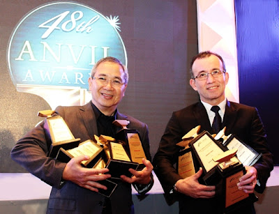 Mon Isberto, Smart Public Affairs Head and Noel Lorenzana, Smart Executive Vice President and Wireless Consumer Division Head showing off Smart's trophy haul during the 48th Anvil Awards ceremony held at the Makati Shangri-La Hotel