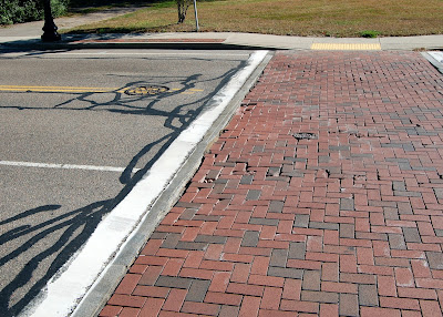 brick cross walk showing increase sign of wearing, brick will be coming out soon