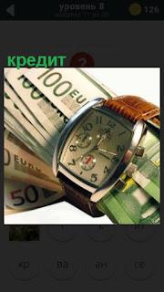 часы и деньги говорящие о взятии кредита на определенный срок