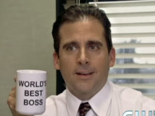 "A man holding a coffee mug with the text ""word's best boss"""
