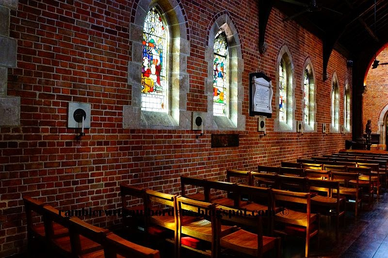 the pews and stained glass windows of St Georges Cathedral Anglican, Perth, WA, Australia