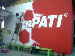 proses pembuatan mural branding telkomsel
