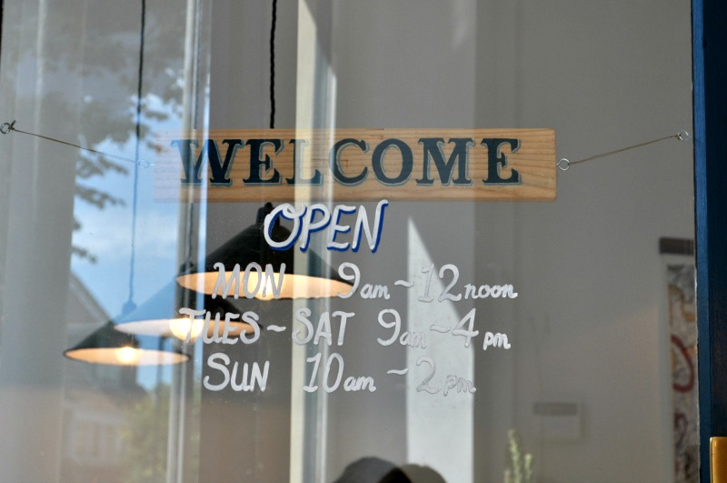 cafe welcome sign