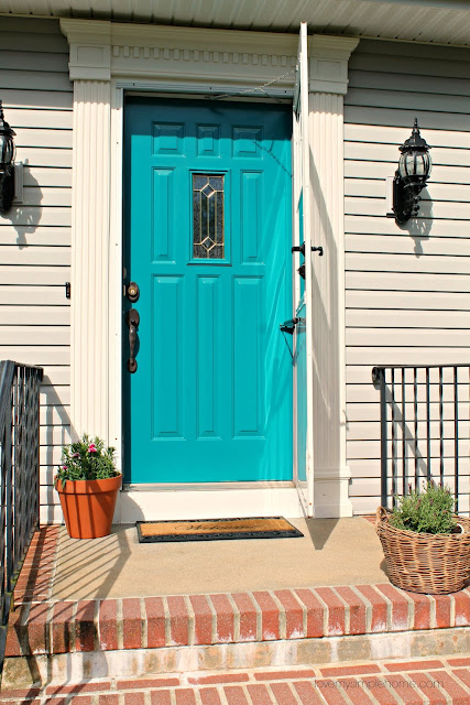 Front door reveal with the color teal