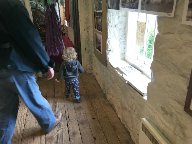 St-Fagans-toddler-in-weavers-barn
