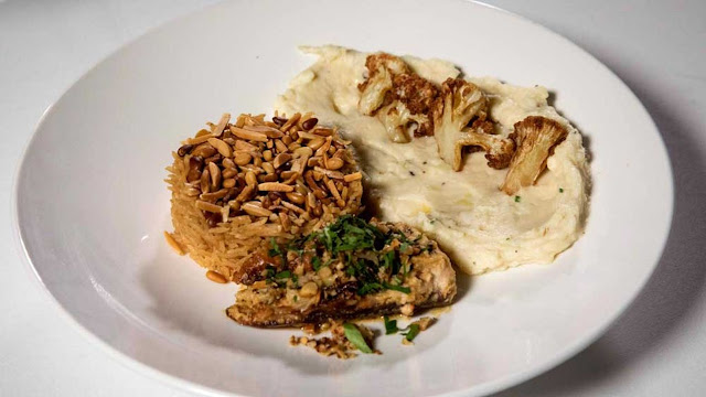 Tahini baked samka hara fish, sayidiya rice, cauliflower and potato mash with fried cauliflower