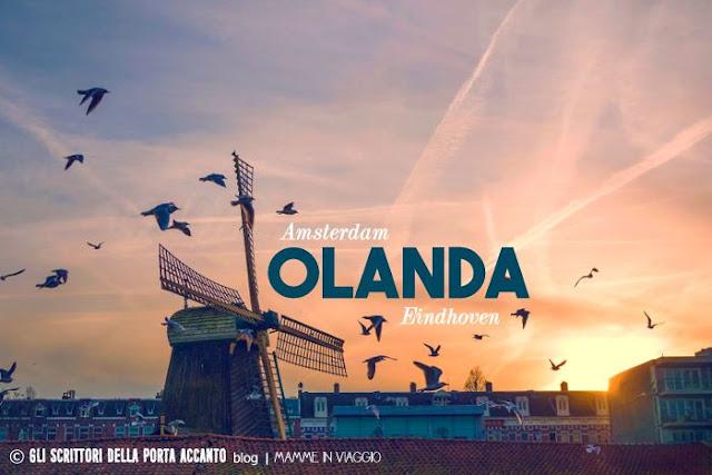 Olanda, Mulino a vento, Tramonto tra i tetti - Credits Vincet Versluis