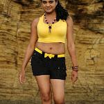 Tashu Kaushik Hot Photos in Black Shorts and Yellow Blouse