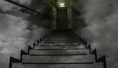 A stairway leading to a door in a dark, cloudy sky.