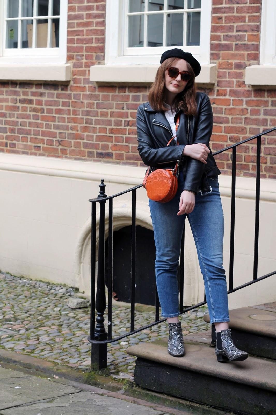 Liverpool fashion blogger outfit with white shirt, blue jeans, snake print boots, black beret, tortoiseshell sunglasses, orange circle bag
