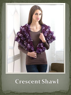 http://www.redheart.com/free-patterns/crescent-shawl