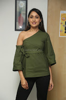 Pragya Jaiswal in a single Sleeves Off Shoulder Green Top Black Leggings promoting JJN Movie at Radio City 10.08.2017 056.JPG