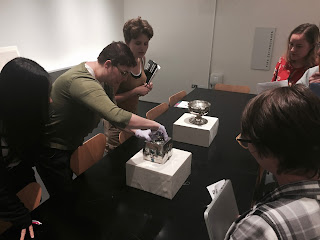 Students from Introduction to Medieval Art examine objects at the Smart Museum of Art with Sara Hindmarch, Head Registrar.
