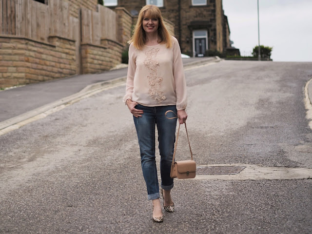 Blush pink embellished top, boyfriend jeans, leopard print bag. Over 40 fashion