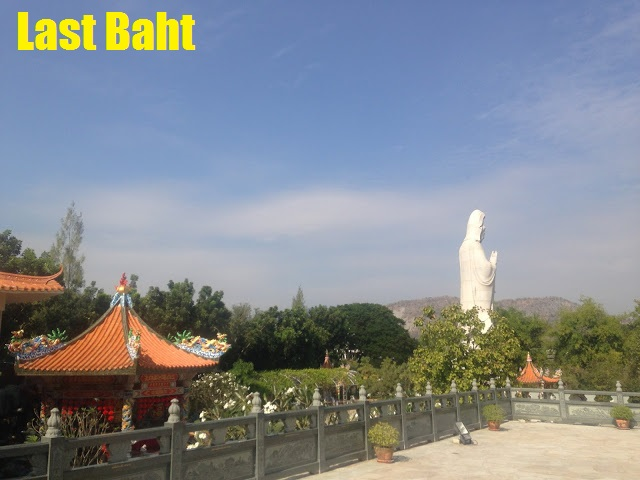 statue of Guanyin looks out from a Chinese temple near the River Kwai in Kanchanaburi, Thailand