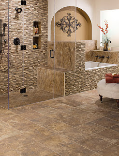 Different styles of tile mix well on the floor & walls of this bath
