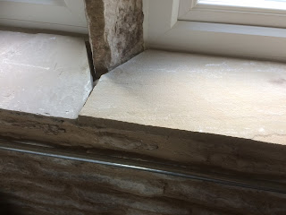 Lay stone windowsills out dry before mortaring them in.