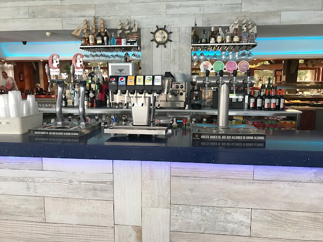 the self serve bar area at pirates village hotel majorca