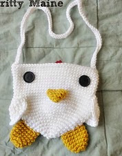 http://www.ravelry.com/patterns/library/barnyard-friend-series-the-rooster-purse