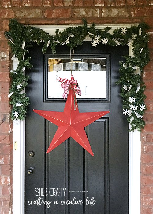 snowflake lights, faux garland, black front door
