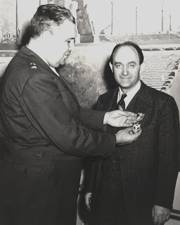 General Leslie R Groves presents Fermi with his Medal of Merit for wartime service to the US