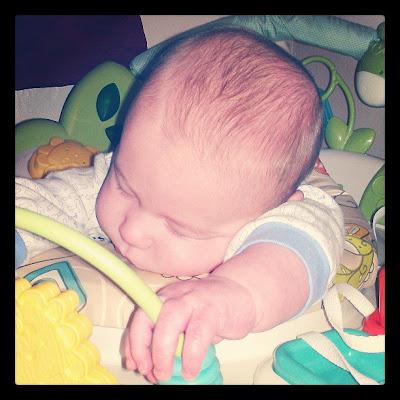 Baby asleep in Jumperoo
