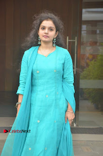 Tamil Actress Preethi Stills in Green Salwar Kameez at Kuzhalosai 2nd Anniversary Fund Raising Event  0025.jpg
