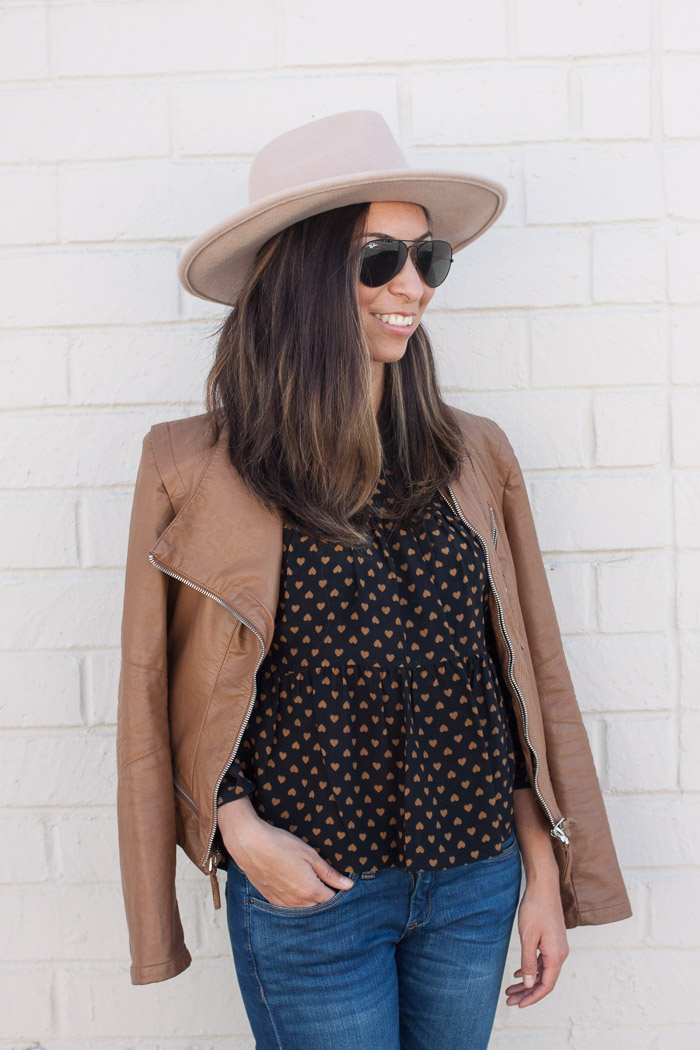 tan moto jacket and silk top