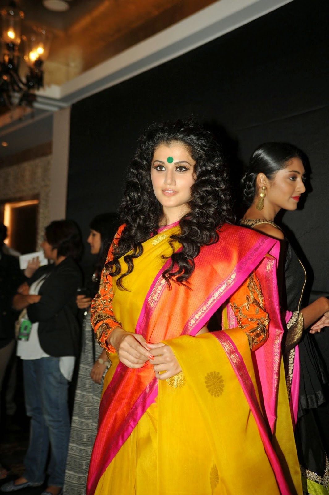 Tapsee Pannu Hot Looking Photos In Yellow Saree